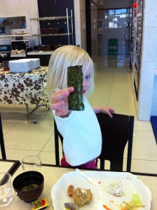 My daughter at 2 1/2 showing me her favorite part of breakfast in Japan, nori(Seaweed) and miso soup :-)